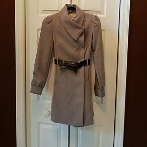 Gray trench coat with black bow belt
